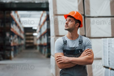 Portrait of young worker in unifrorm that is in warehouse