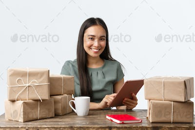 Small business owners, startup and e-commerce concept. Smiling asian businesswoman work from home