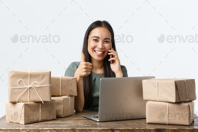 Small business owners, startup and e-commerce concept. Smiling asian woman manage online store