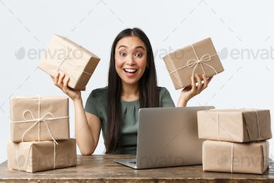 Small business owners, startup and e-commerce concept. Smiling asian businesswoman working from home