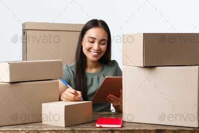 Small business owners, startup and e-commerce concept. Smiling asian businesswoman, online store