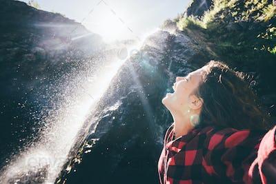 girl enjoing the waterfall.