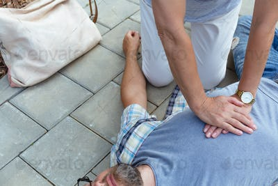 Heart massage performed on the victim of an accident lying on the street
