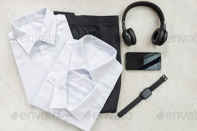 Back to school concept with uniform and electronic devices