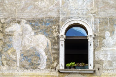 Trento, Italy: painted facade of historic buildings in the cathedral square