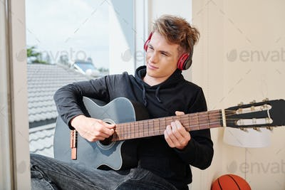 Creative teenager with guitar