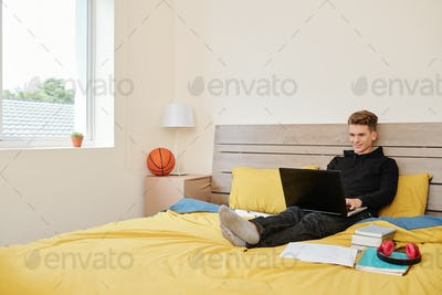 Schoolboy attending online class