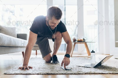 Handsome man working out at home
