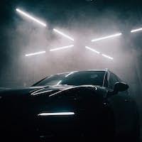 Sports SUV in dark modern barn