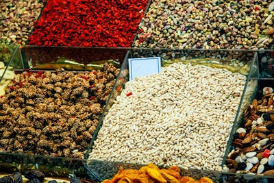The abundance of nuts, fruits, sweet things in boxes at the Barcelona market