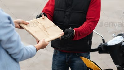 Courier Man Giving Document Package To Customer Outdoors, Closeup