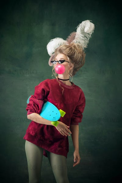 Young woman as Marie Antoinette on dark background. Retro style, comparison of eras concept