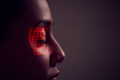 Facial Recognition Technology Concept As Woman Has Red Grid Projected Onto Eye In Studio