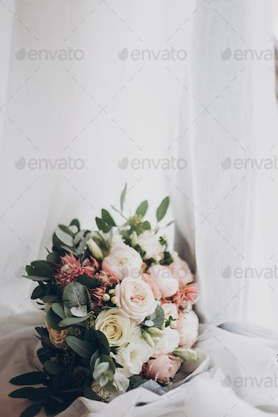Modern wedding bouquet. Stylish wedding bouquet of pink roses and green eucalyptus