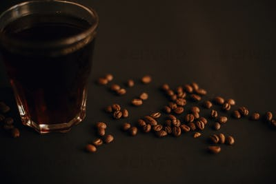 Coffee beans and fresh coffee in glass cup