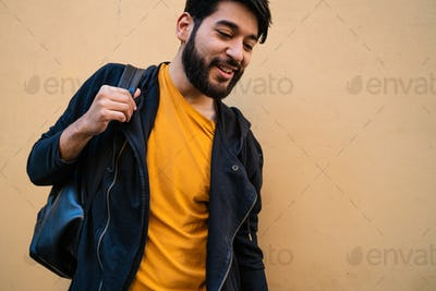 Beared man with backpack on his shoulders.
