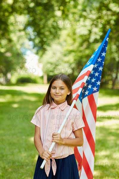 Girl Holding American Flag Outdoors