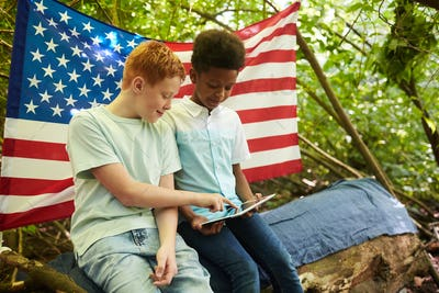 American Boys Hiding in Forest