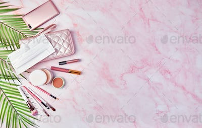 Flat lay with set of decorative cosmetics, makeup tools and feminine accessories.