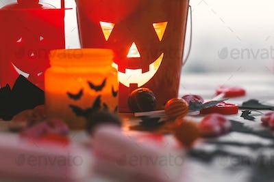 Halloween candy , jack o lantern bucket, candle and skulls