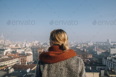 Rear view of woman looking at city