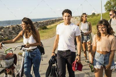 Friends walking by sea