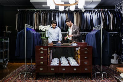 Men in clothing store