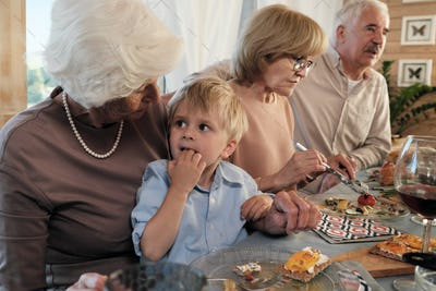 Grandparents with grandson at home