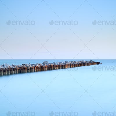 River estuary breakwater jetty seascape. Long exposure.