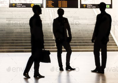 Silhouette business colleagues standing at railroad station