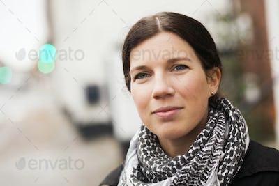 Close-up portrait of confident woman outdoors