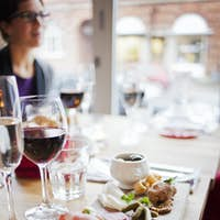 Woman sitting at dining table at restaurant