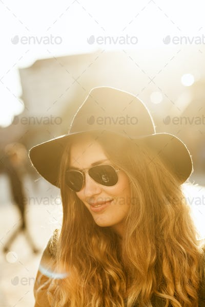 Smiling young woman standing on city street