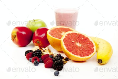 Close-up of various fruits and juice on white background