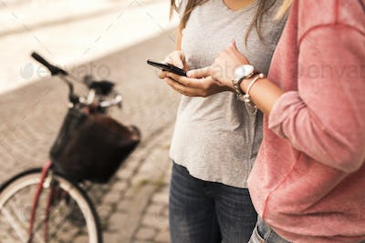 Young women using mobile phone