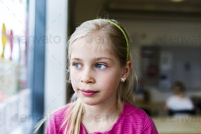 Girl (8-9) in classroom