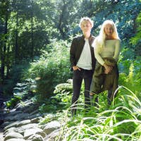 Teenage couple (16-17) standing by stream in park