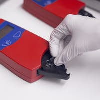 Blood testing equipment being used