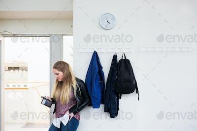 Female student using smartphone in school