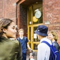 Students (14-15) talking by school