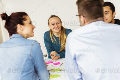 Colleagues talking during business meeting