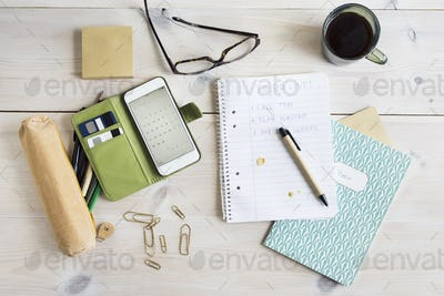 To-do-list, smart phone and office supplies on desk