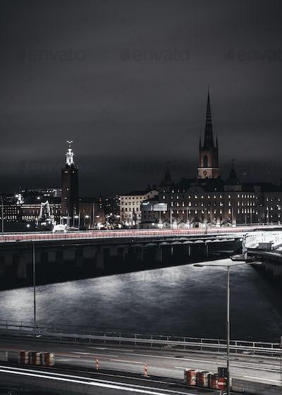 Illuminated bridges over river in city at night