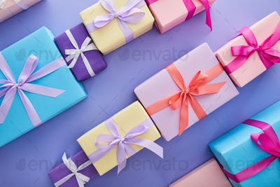 Flat Lay With Colorful Presents With Bows on Purple Background