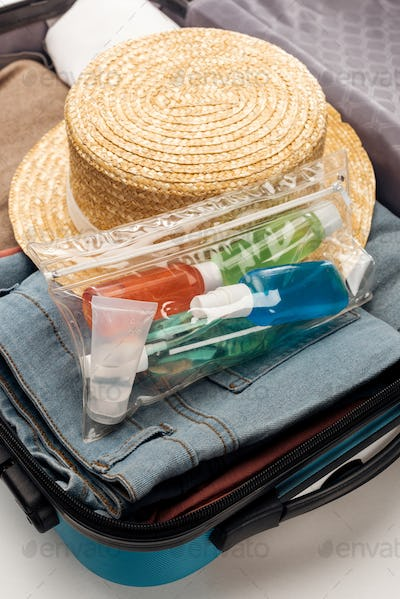 Travel Bag With Cosmetic Bag With Bottles, Clothes And Hat