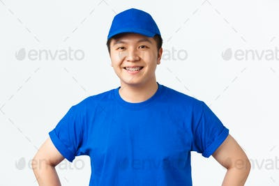 Online shopping, fast shipping, employees and home delivery concept. Close-up of cheerful asian male