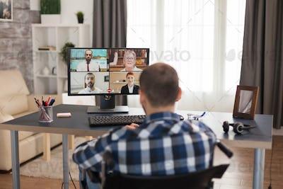 Disabled man having online meeting