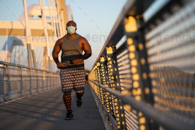 Man jogging with face mask