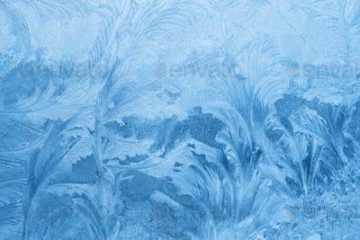 Ice pattern close-up on winter window glass