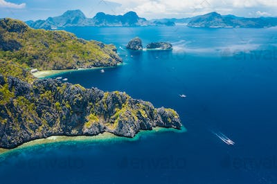 Aerial drone view of a tropical Mantiloc island coastline and open ocean. El Nido, Palawan island